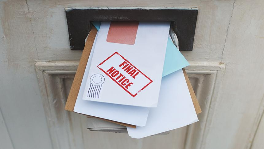 Uncollected post in a letterbox