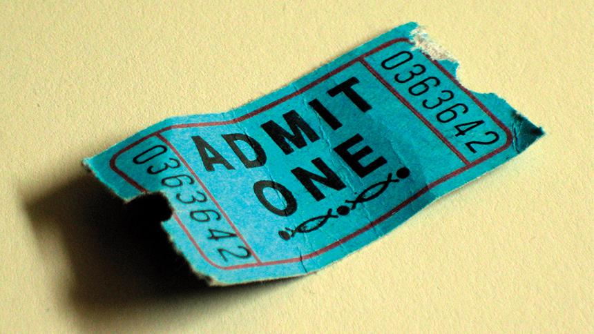 Small green cinema ticket with 'Admit One' on it
