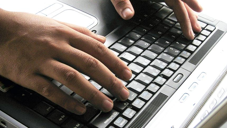 Someone using a computer keyboard