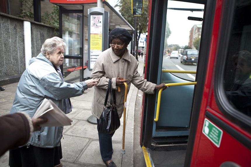 Two ladies getting on a bus