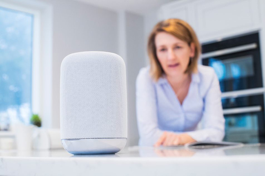 Woman with home assistant tech