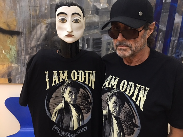 Ian McShane standing next to a mannequin