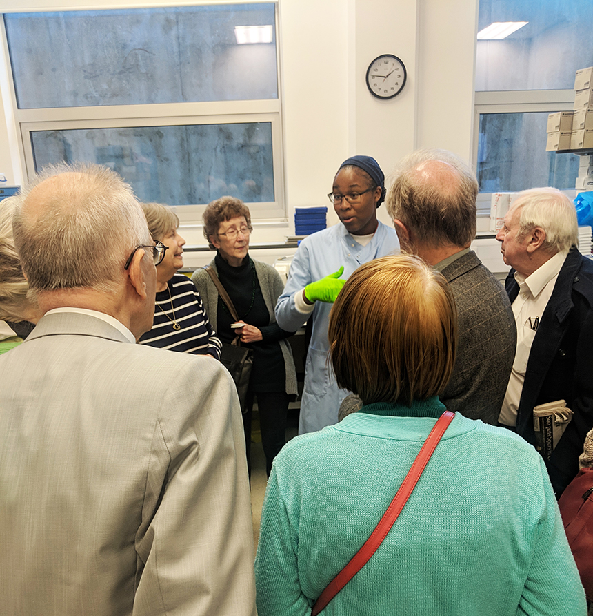 Shalmai speaks to study partners visiting the brain bank