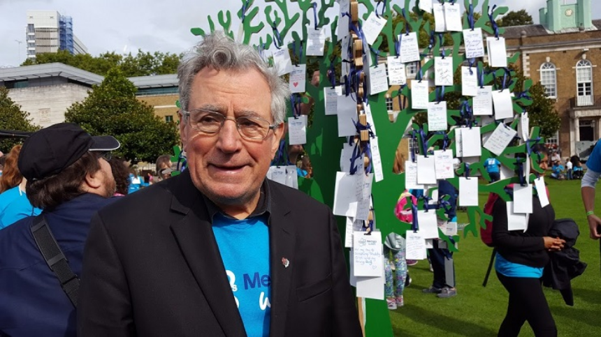 Terry Jones in front of wooden 'memory tree'