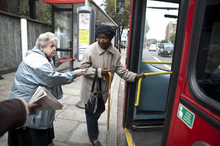 Two women getting on a London bus