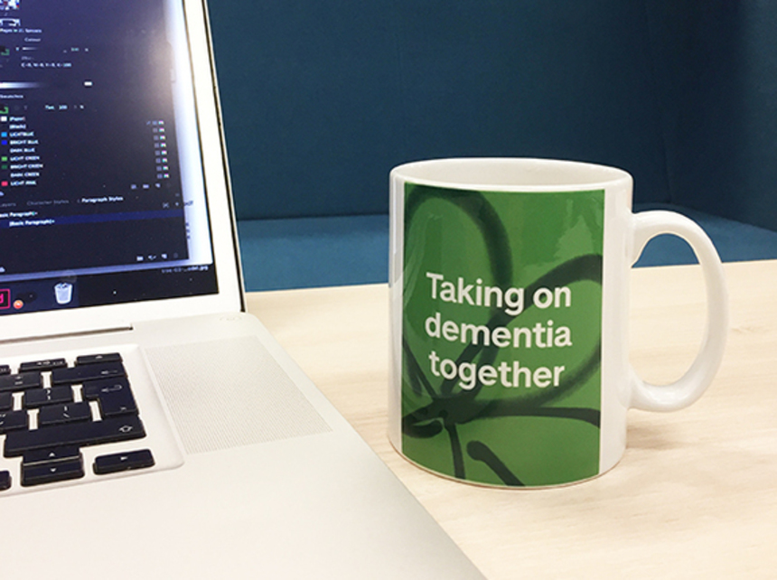 A coffee mug that reads 'Taking on dementia together'