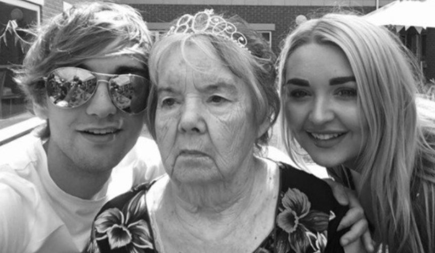 Nicholas with his sister and grandmother celebrating her 80th birthday