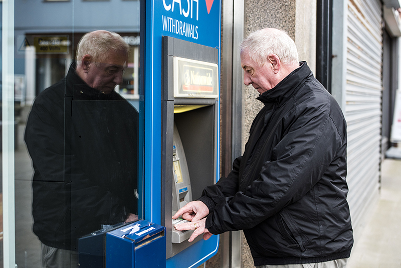 Man using an ATM cash point