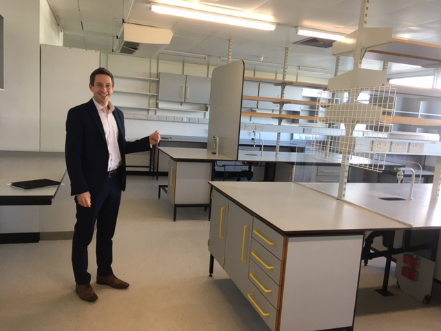Doug Brown doing a thumbs up in the new, empty labs.