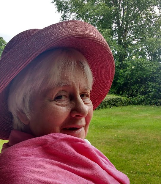 Mary, who lives with dementia, smiling into the camera,