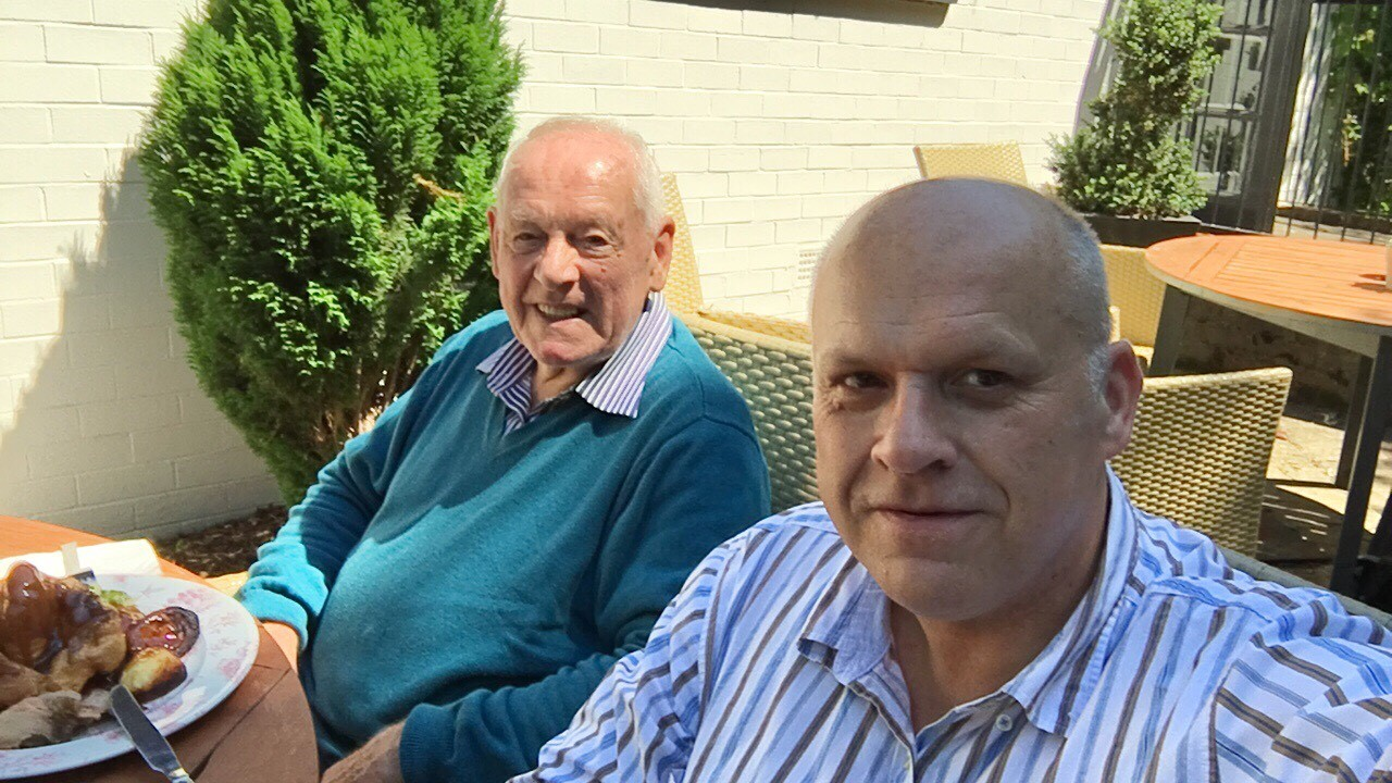 Andy's dementia story: Andy and his dad smiling in the sun.