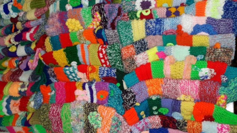 A collection of 50 knitted cannula sleeves