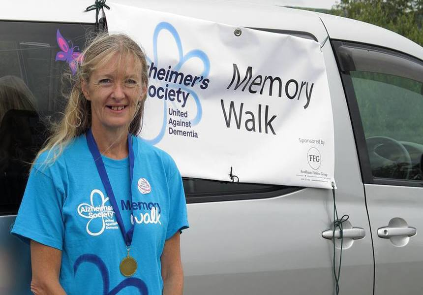 Tina with Memory Walk medal and banner