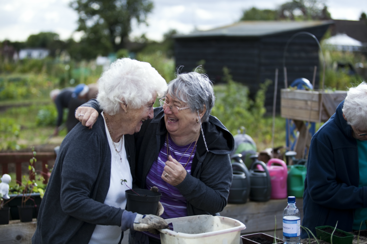Two women with dementia laughing