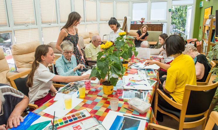 A Paints Pals party with schoolchildren and people with dementia.