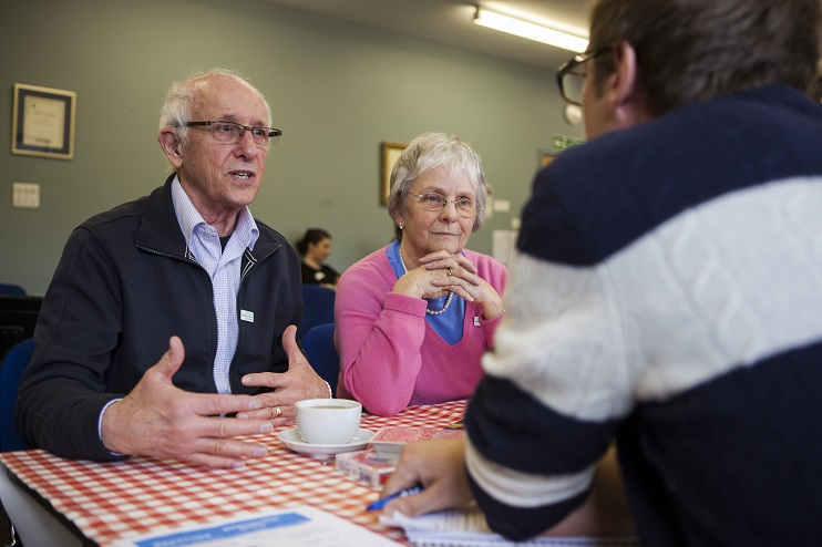 Dementia Support Officer speaking to two people