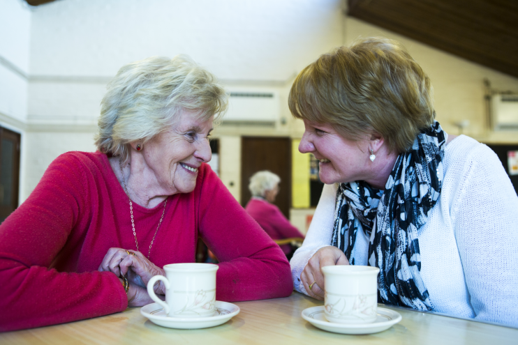 Two women talking over a cup of tea