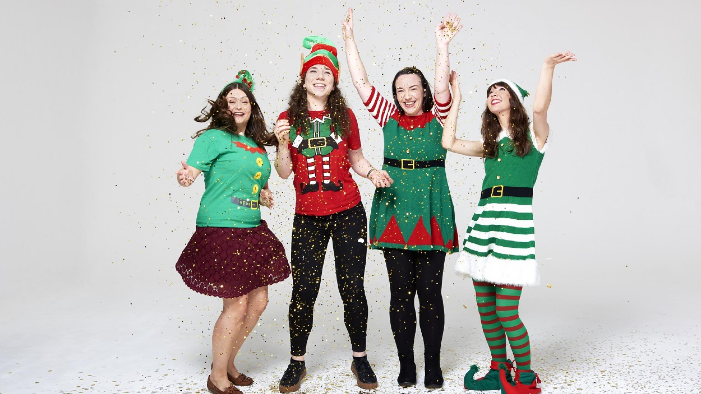 Four smiling women dressed up for Elf Day