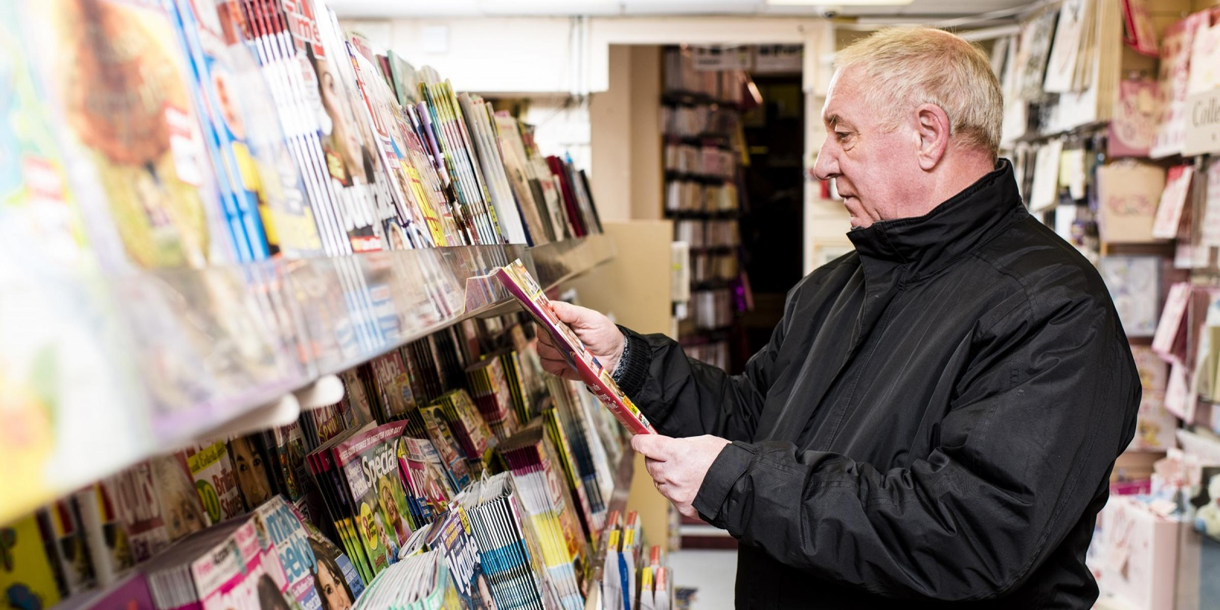 A man with dementia reading a magazine
