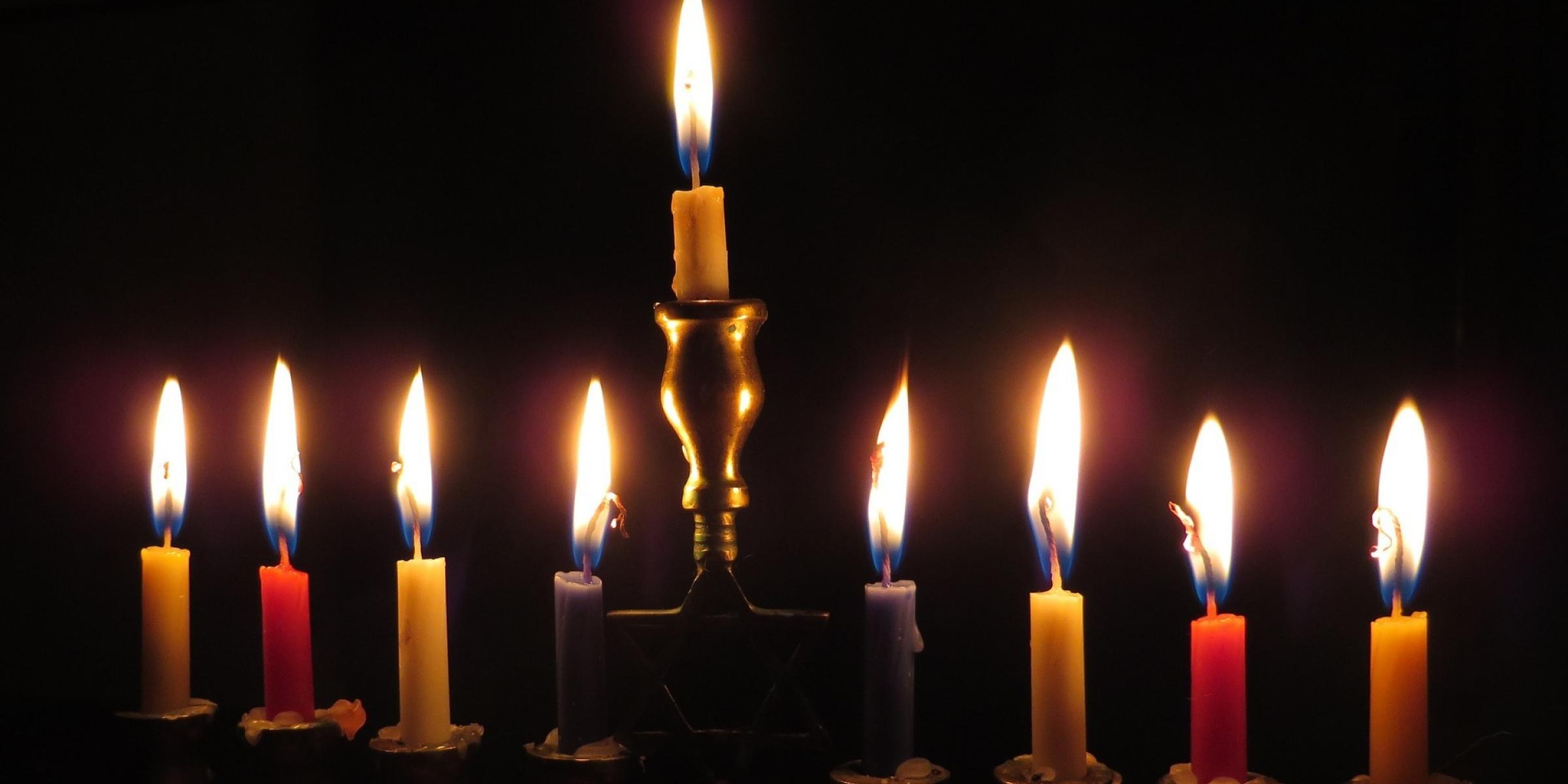 Nine lit menorah candles for a dementia-friendly Hanukkah
