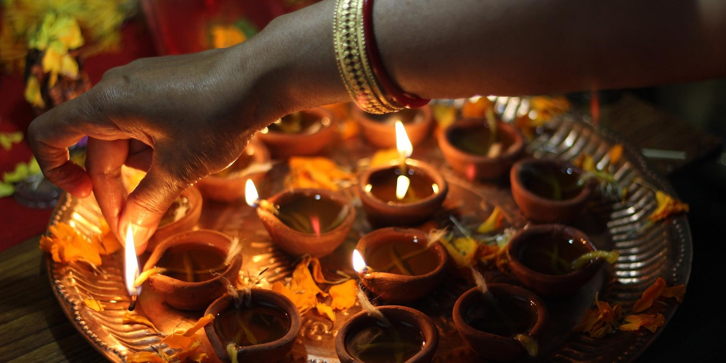 Lighting candles for Diwali