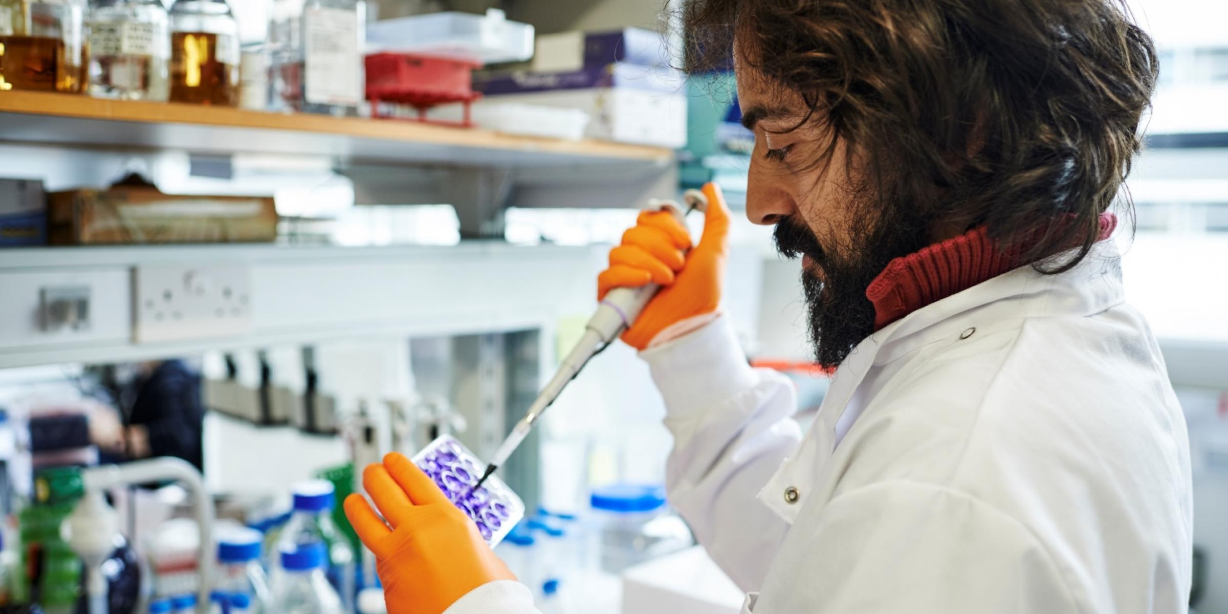 Researcher pipetting at UK DRI