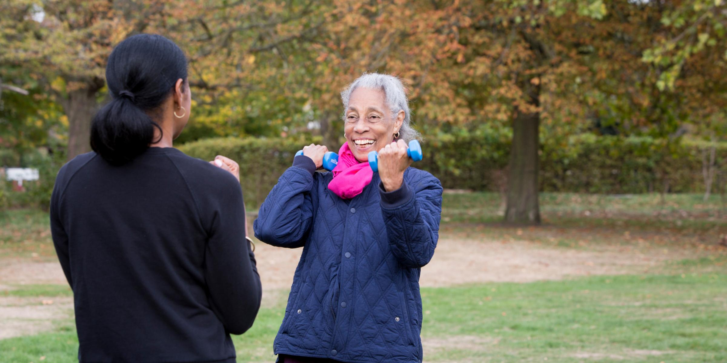 Daphne and Michelle outside in a park enjoying light exercise