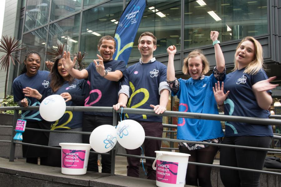 Alzheimer's Society's fundraising team cheering from the sidelines