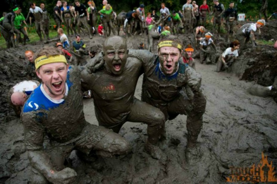 3 young men in mud