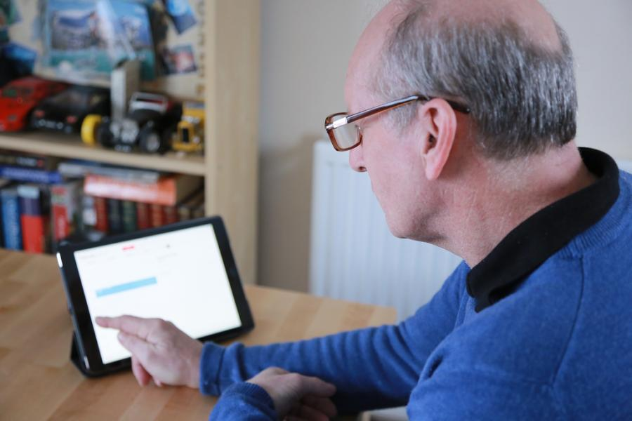 A man with dementia using a tablet computer