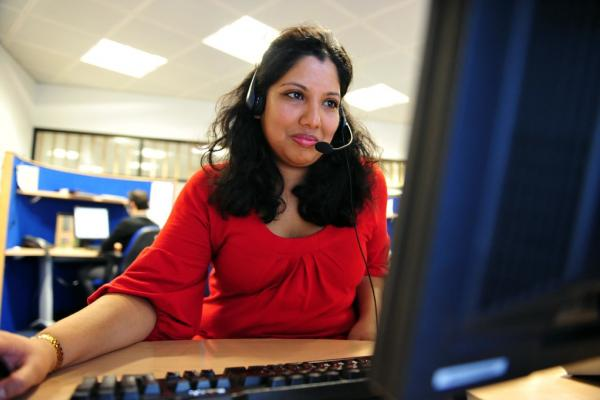 A woman using a PC while volunteering in our offices