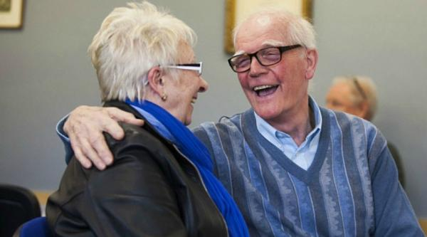 Two older people laughing