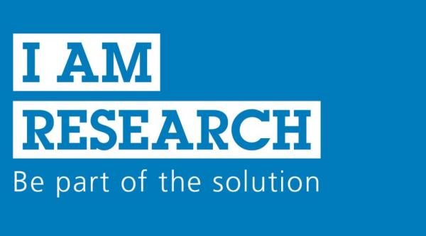 Text on photo reading 'I am research. Be part of the solution'.