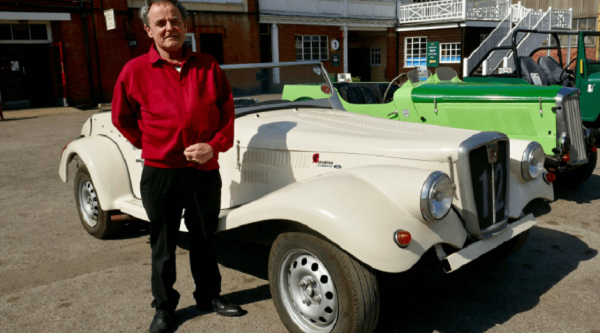 John side by side volunteer with a vintage car