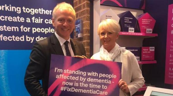 Sandy Sweet, whose mother has dementia, with her local MP, Dr Phillip Lee