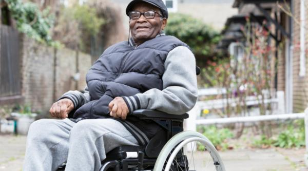 Man in a wheelchair smiling