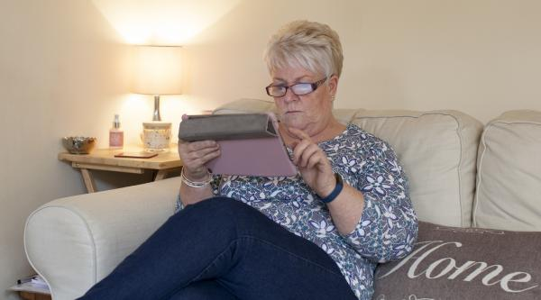 Woman looking at tablet iPad - dementia information
