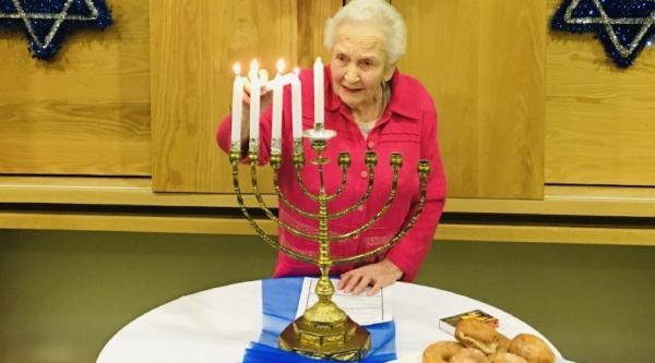 Dorothea lights the menorah
