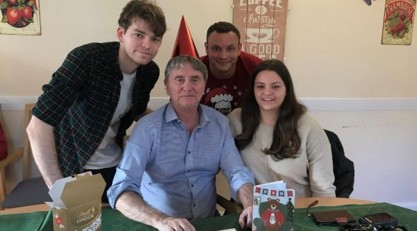 Jess with her brothers and their dad at Christmas 2019