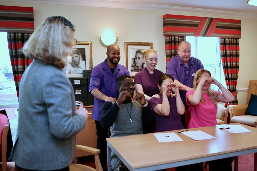 Care home staff give shoulder massages as part of their training