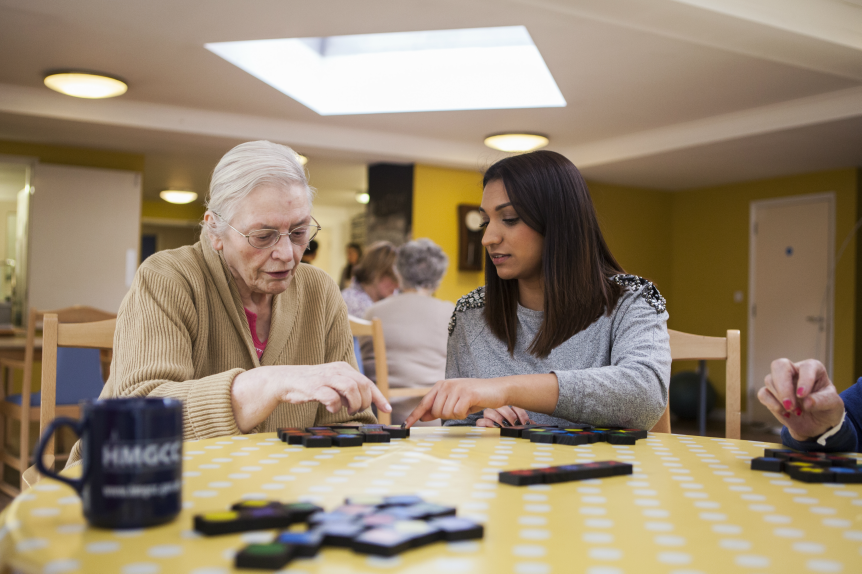 Women with dementia using a puzzle at a dementia service