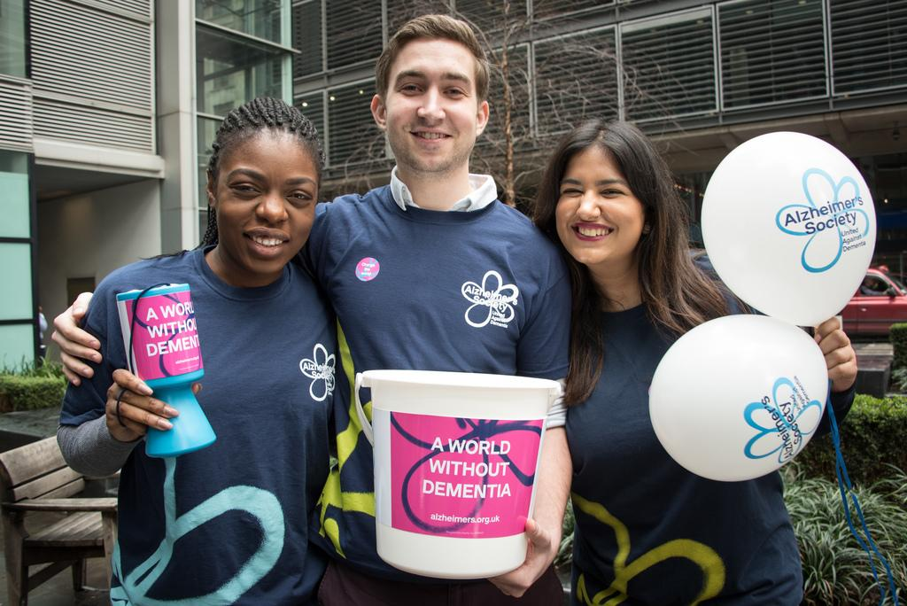 Community fundraisers with buckets and balloons