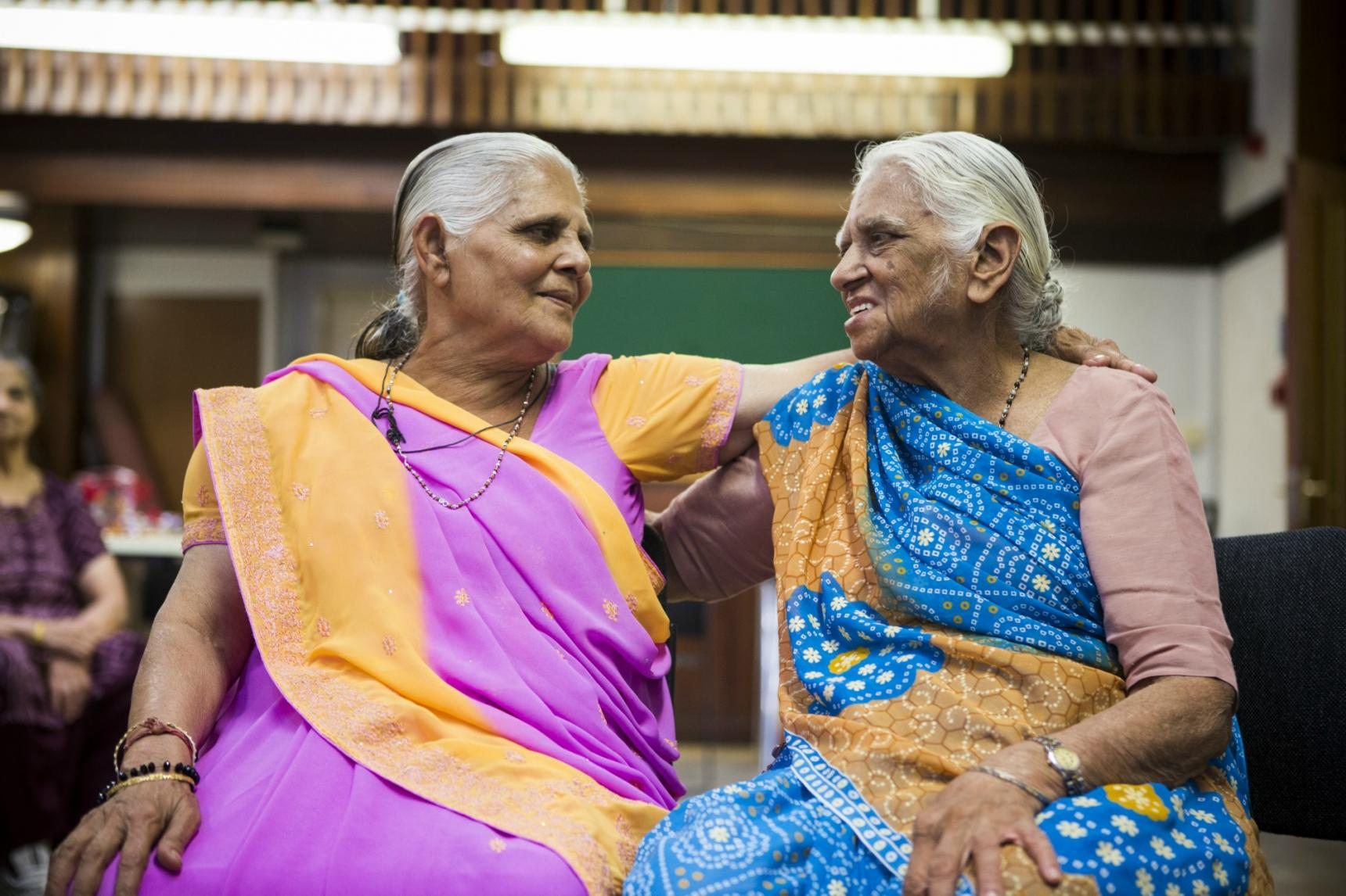 Two women in saris at church