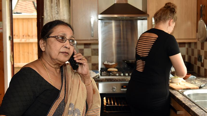 Anima Bhuiya at home with homecare worker Sarah.