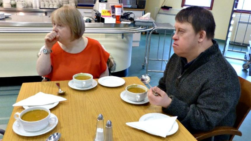 Couple with Down's syndrome at a cafe