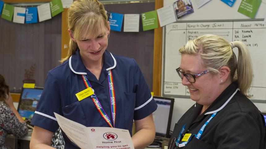 Staff at Musgrove Park Hospital looking at Home First information