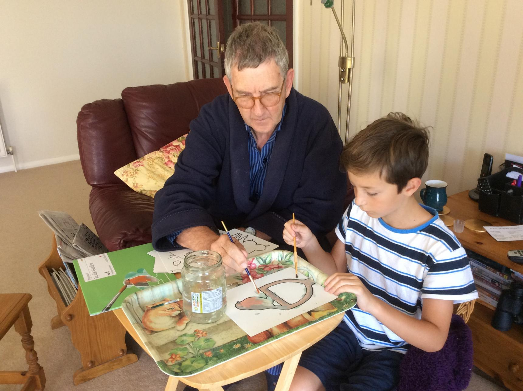 Keith painting with his grandson