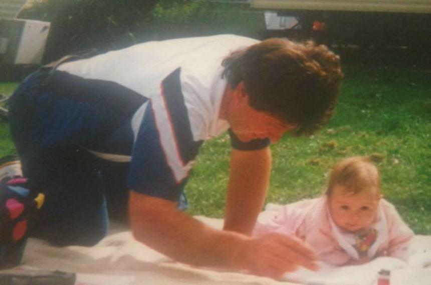 Alex as a baby with her dad, Dave