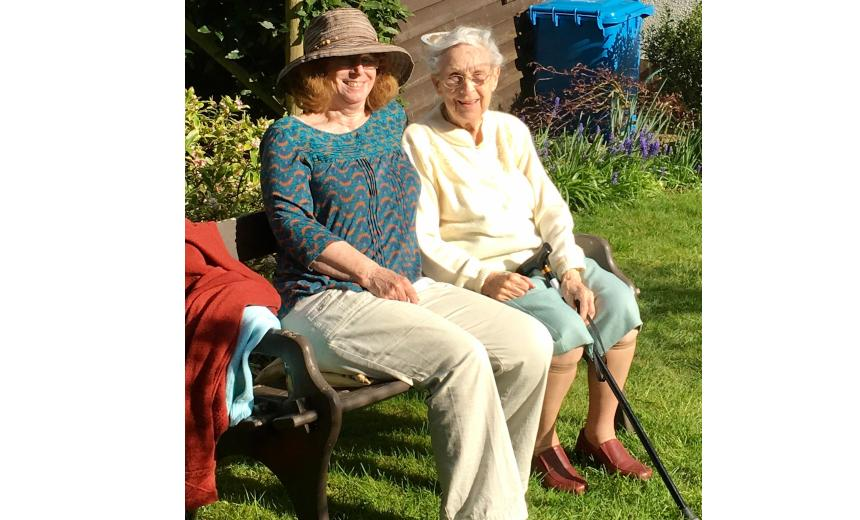 Janet and her mother, Doris, sitting on a bench