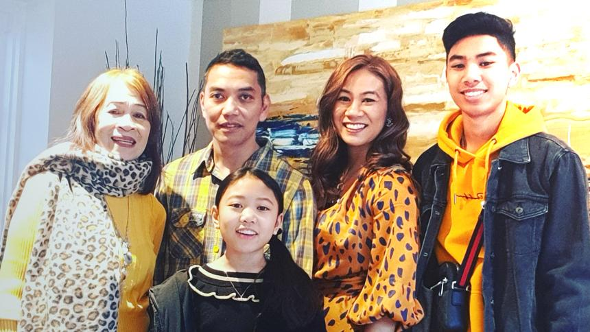 Michelle Macadangdang with her family